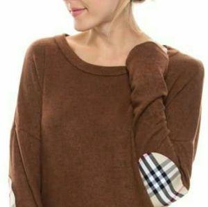 Brown sweater with plaid elbow patch